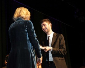 Alex Raineri receives award from Elizabeth Chernov