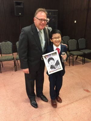 Darryl Coote with 11 year old Luik Jie En, winner of the 11-14 section.
